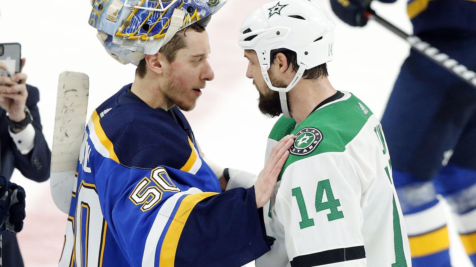 Dallas Stars left wing Jamie Benn (14) congratulates St. Louis Blues goaltender Jordan Binnington (50) on their win in the second overtime period at the Enterprise Center in St. Louis, Tuesday, May 7, 2019. The Dallas Stars lost, 2-1. The teams were playing in the Western Conference Second Round Game 7 of the 2019 NHL Stanley Cup Playoffs. (Tom Fox/The Dallas Morning News)