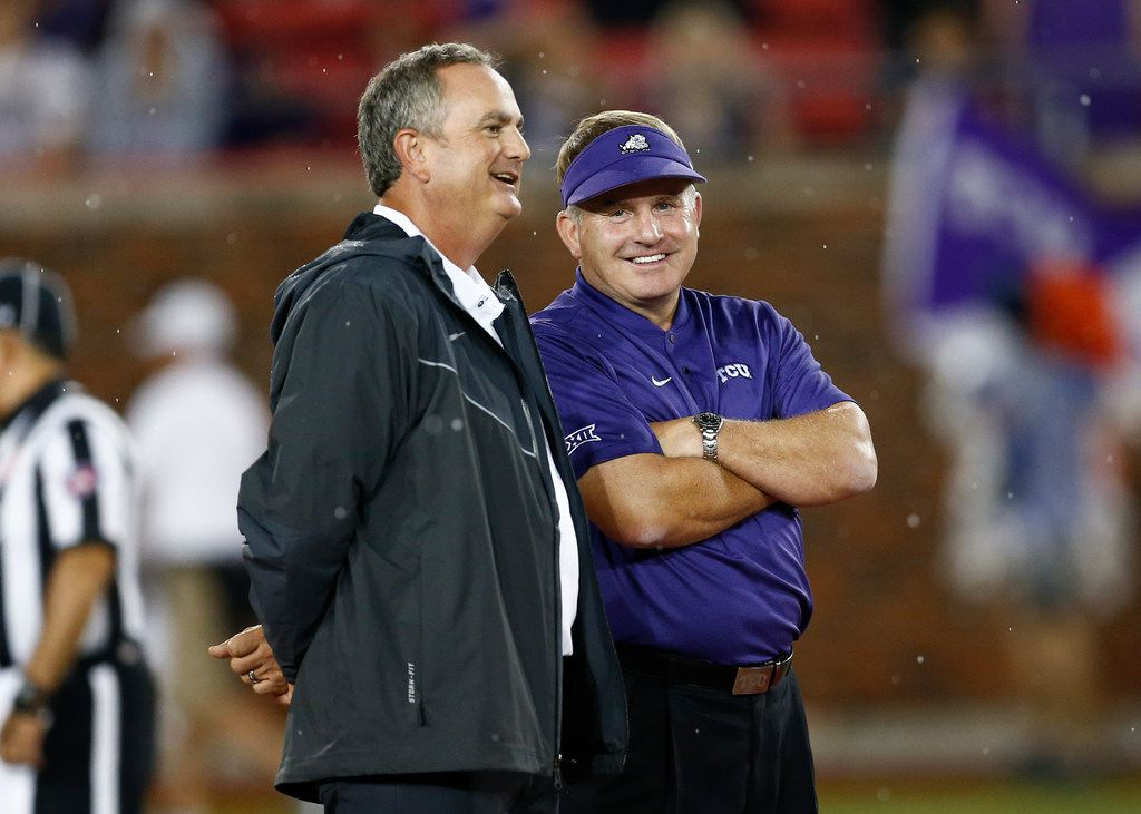 TCU coach Gary Patterson (right) and SMU coach Sonny Dykes talk before a game on Friday, Sept. 7, 2018, in Dallas. (AP Photo/Jim Cowsert)