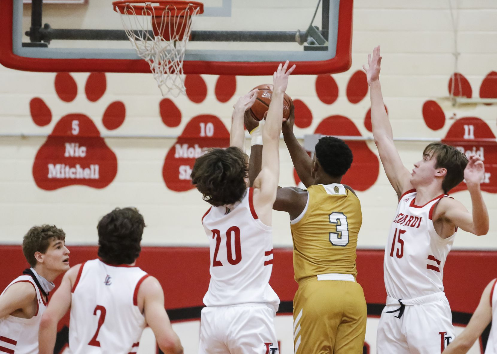 South Oak Cliff senior forward Antonio Patterson (3) attempts a shot as Lovejoy junior forward Pete Peabody (20) and senior forward Sean Calhoun (15) defend during the first half of a Class 5A area-round playoff basketball game at Lake Highlands High School in Dallas, Wednesday, February 24, 2021. (Brandon Wade/Special Contributor)