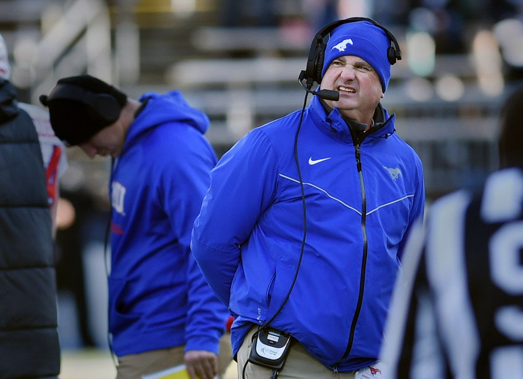 SMU head coach Sonny Dykes looks at the score in the second half of an NCAA college football game against Connecticut Saturday, Nov. 10, 2018, in East Hartford, Conn.(AP Photo/Stephen Dunn)