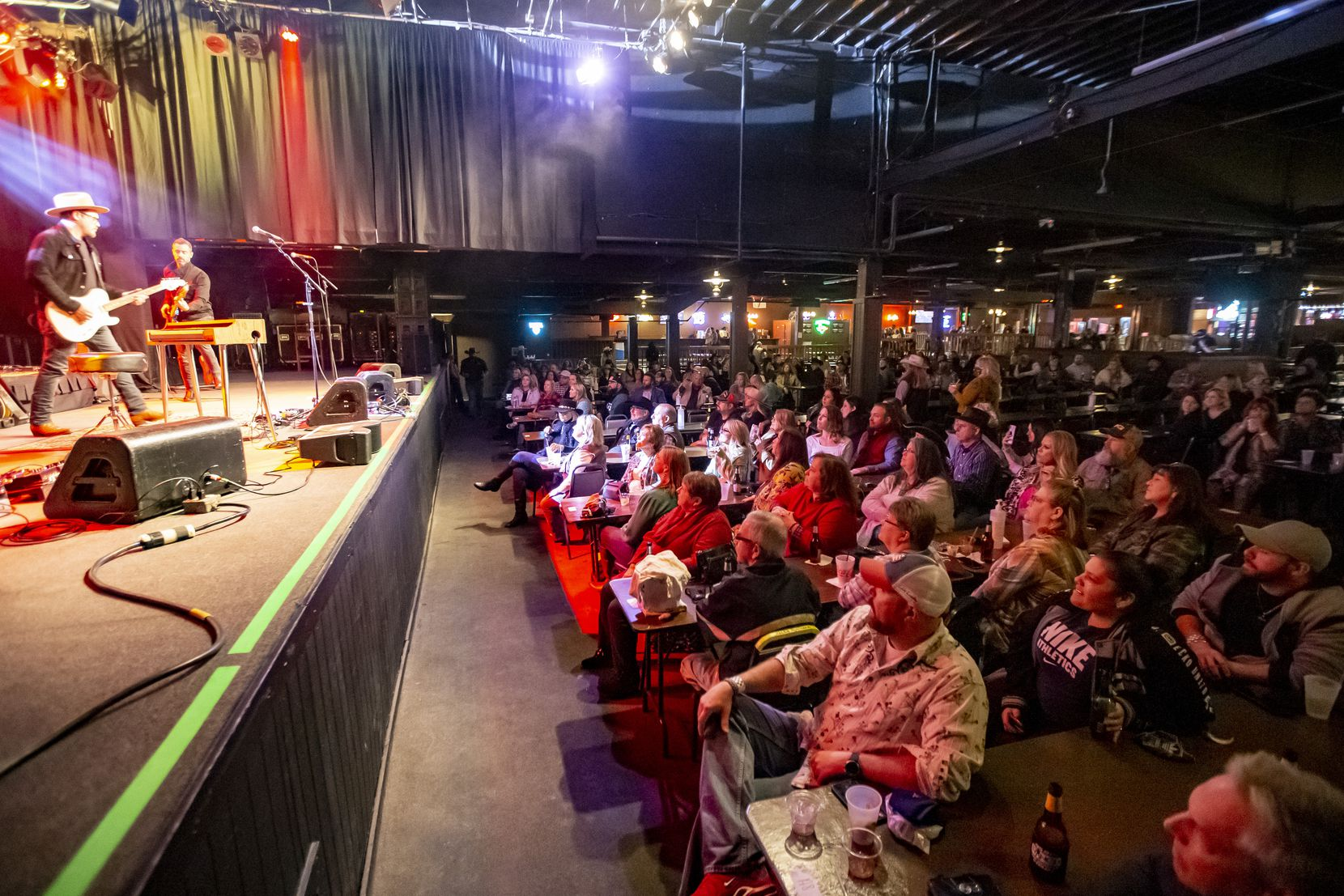 Concertgoers sat shoulder to shoulder, many without masks, during a Josh Weathers concert at Billy Bob's on Jan. 15. At the time, Billy Bob's required patrons to wear masks unless eating or drinking.
