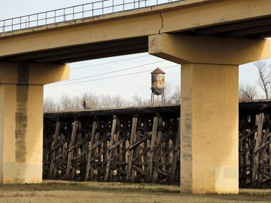 The old Atchison Topeka & Santa Fe (AT&SF) trestle bridge structure spans 1,000 feet in the Dallas Floodway -- acting as a sieve, says the Army Corps of Engineers, collecting debris and exacerbating flooding between the levees.