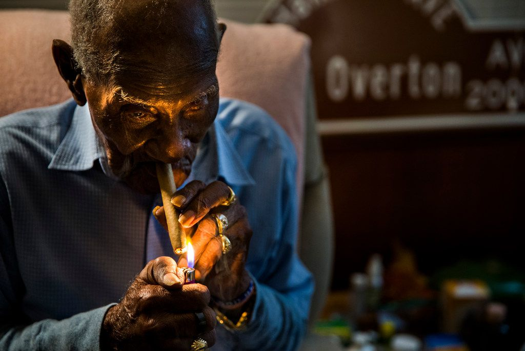 Richard Overton lights his first cigar of the day at 4:37 a.m. at his home in Austin. He rises between 3 and 5 a.m. and smokes a dozen cigars a day. He will turn 112 on Friday.