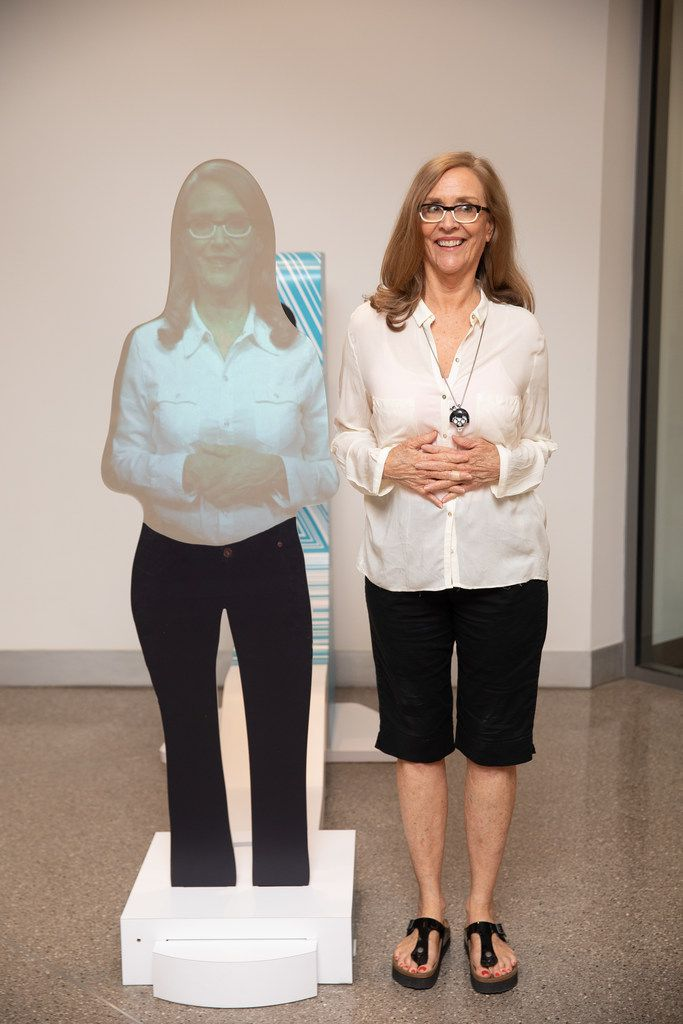 Sarah Bird poses for a portrait at the Austin Central Library, where a hologram of Bird greets visitors.