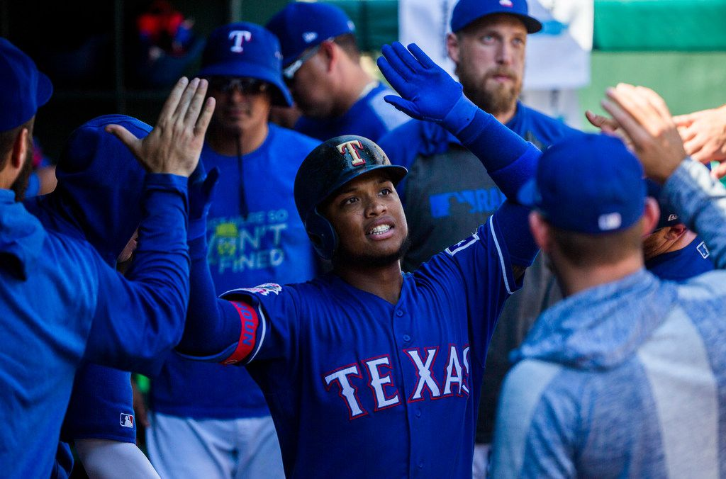 Texas Rangers left fielder Willie Calhoun (5) celebrates a home run during the seventh inning of an MLB game between the Boston Red Sox and the Texas Rangers on Thursday, September 26, 2019 at Globe Life Park in Arlington. (Ashley Landis/The Dallas Morning News)
