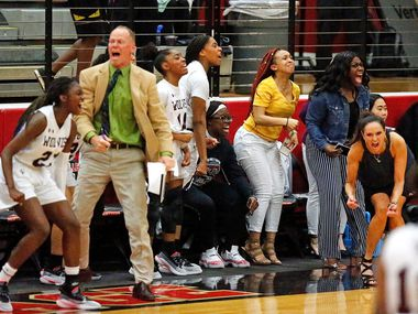 The Timberview High School bench errupts as they pull away during the second half as The Colony High School hosted Timberview High School in a Class 5A Region I quarterfinal girls basketball game at Colleyville Heritage High School on Monday night, February 24, 2020.