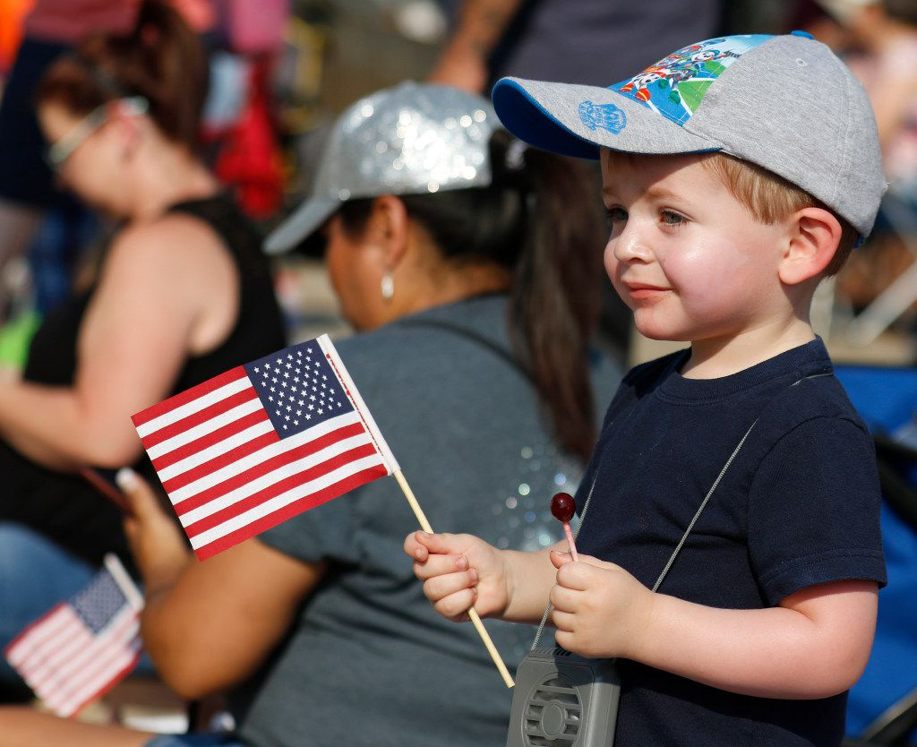 Lucas Maxon, 2, of Rowlett observes Garland's annual Labor Day Parade in downtown Garland in 2017.