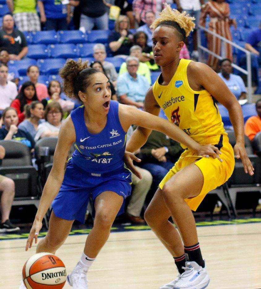 Dallas Wings guard Brooke McCarty-Williams (1) dribbles baseline against the defense of Indiana Fever guard Paris Kea (7) during first half action. The two teams played their WNBA preseason game at UT-Arlington's College Park Center in Arlington on May 19, 2019.  (Steve Hamm/ Special Contributor)
