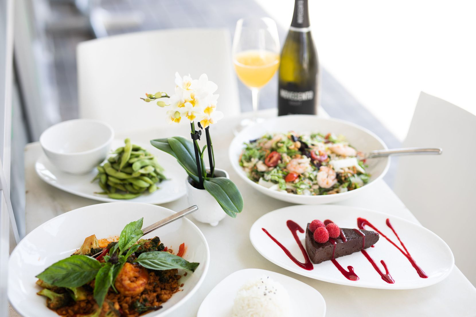 Asian Mint's Thai Mother s Day Meal Kit includes edamame, Asian noodle salad, shrimp and chicken basil with jasmine rice, chocolate flourless cake and a pineapple mimosa kit.