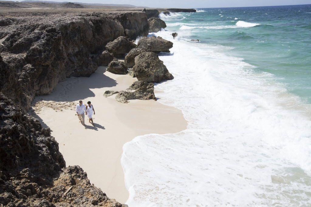 On the north side of Aruba, visitors can take in the Natural Pool, a beachside swimming hole closed off from the ocean by rocks and volcanic stone.