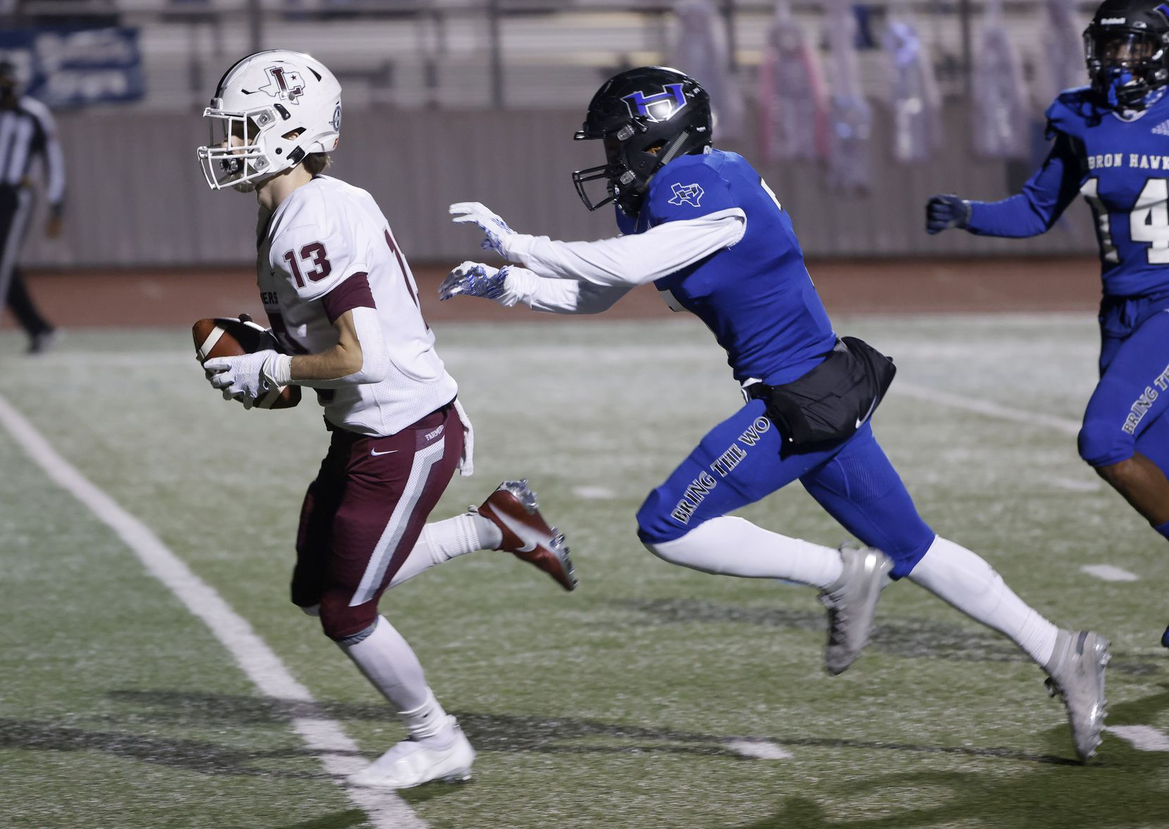 Lewisville receiver Brent Allen (13) scores a a touchdown as he is chased by Hebron's Trenton Bronaugh (7) during their District 6-6A high school football game on Dec. 4, 2020. (Michael Ainsworth/Special Contributor)