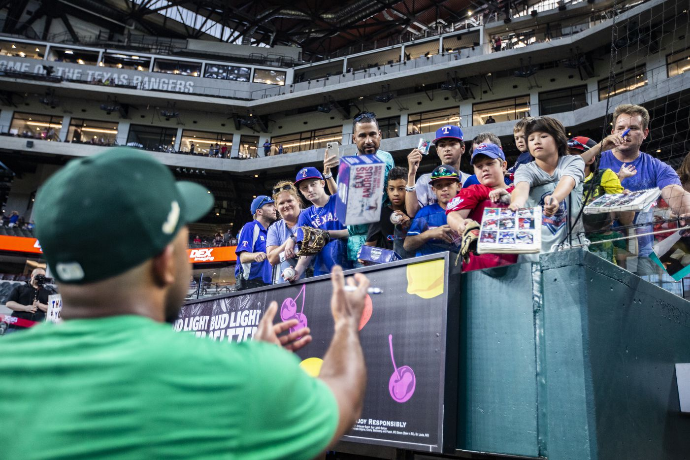 Oakland Athletics shortstop Elvis Andrus autographs memorabilia for fans before a game against the Texas Rangers in Arlington, Monday, June 21, 2021. (Brandon Wade/Special Contributor)