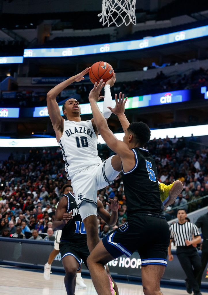 Sierra Canyon's Amari Bailey (10) shoots of over Duncanvilles' Micah  Peavy (5) during their high school boys basketball game during the Thanksgiving Hoopfest in Dallas, Tx, Saturday, Nov. 30, 2019. (Michael Ainsworth)