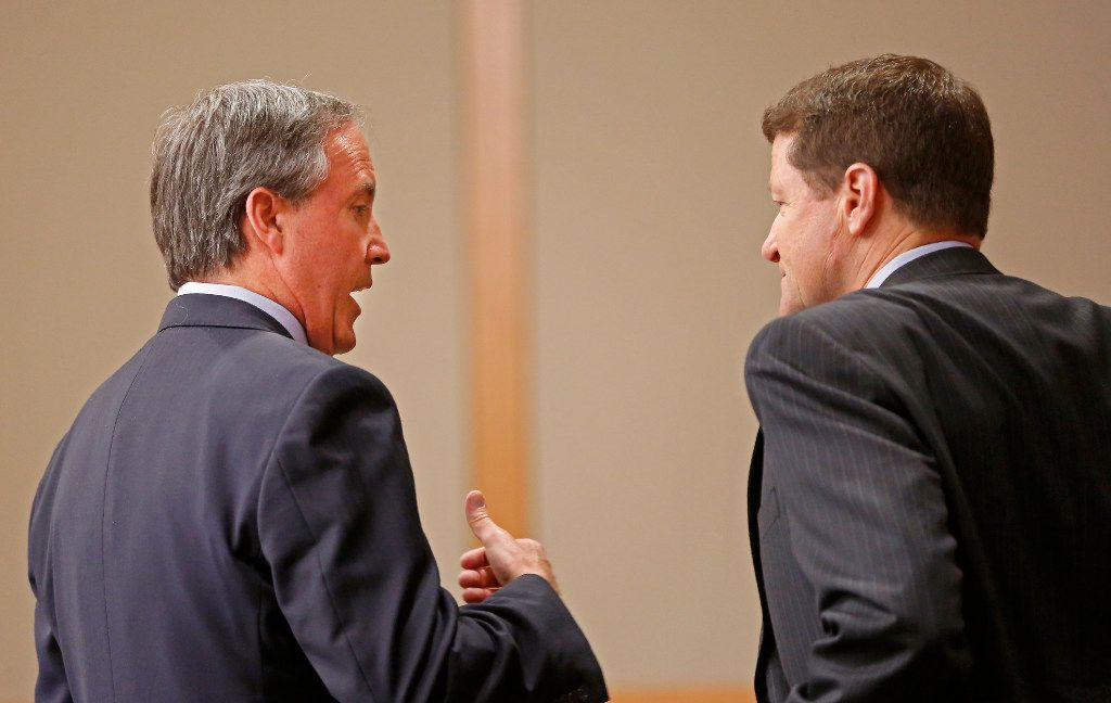 Texas Attorney General Ken Paxton (left) talks with his attorney Bill Mateja during his pretrial hearing at Collin County Courthouse in McKinney, Texas, Thursday, Feb. 16, 2017. (Jae S. Lee/The Dallas Morning News)