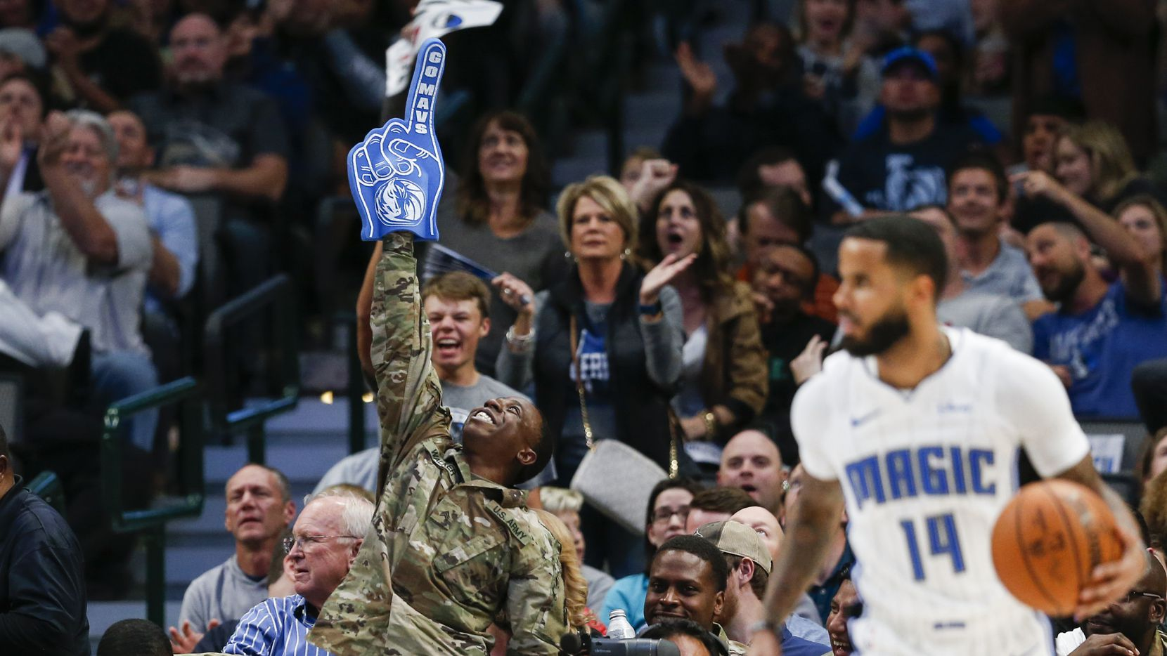 Armed forces members celebrate from the sidelines during the third quarter of an NBA game between the Dallas Mavericks and the Orlando Magic on Wednesday, Nov. 6, 2019 at American Airlines Center in Dallas. (Ryan Michalesko/The Dallas Morning News)