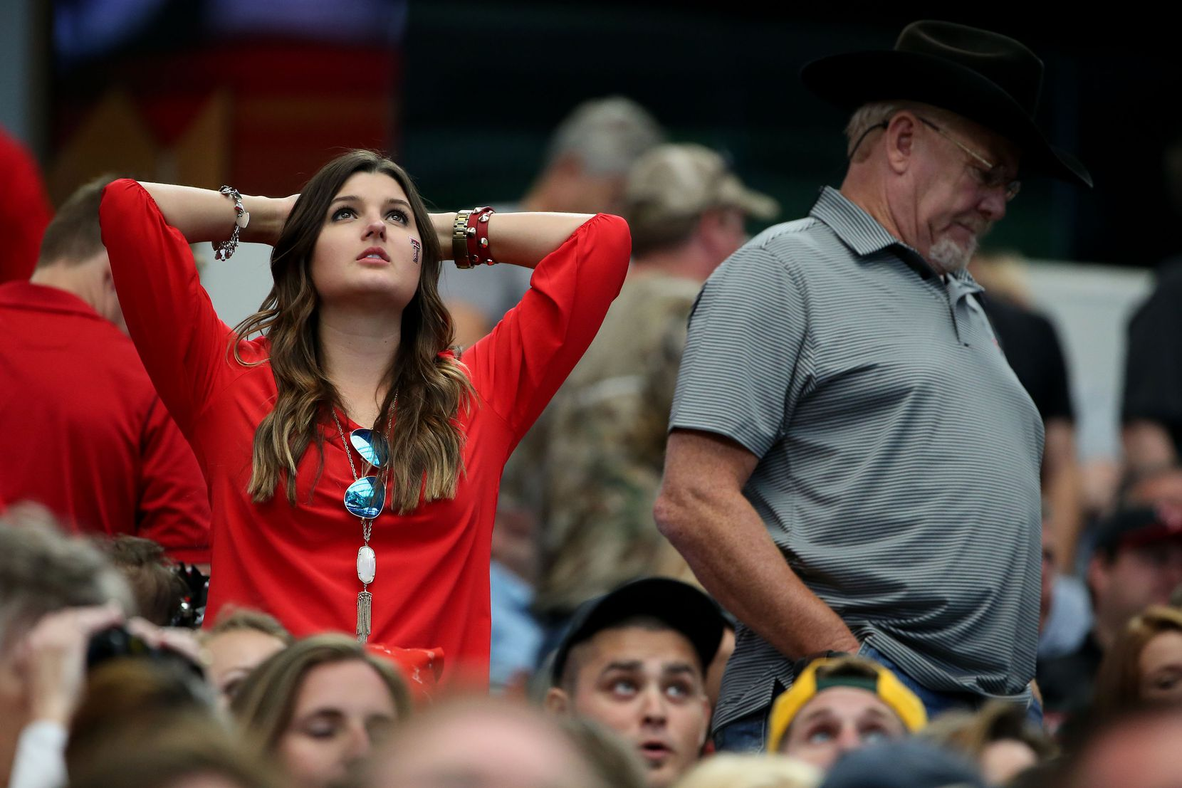 A Texas Tech Red Raiders fan reacts to a fumble call in the first half during an NCAA football game between Texas Tech and Baylor at AT&T Stadium in Arlington, Texas Saturday October 3, 2015. (Andy Jacobsohn/The Dallas Morning News)
