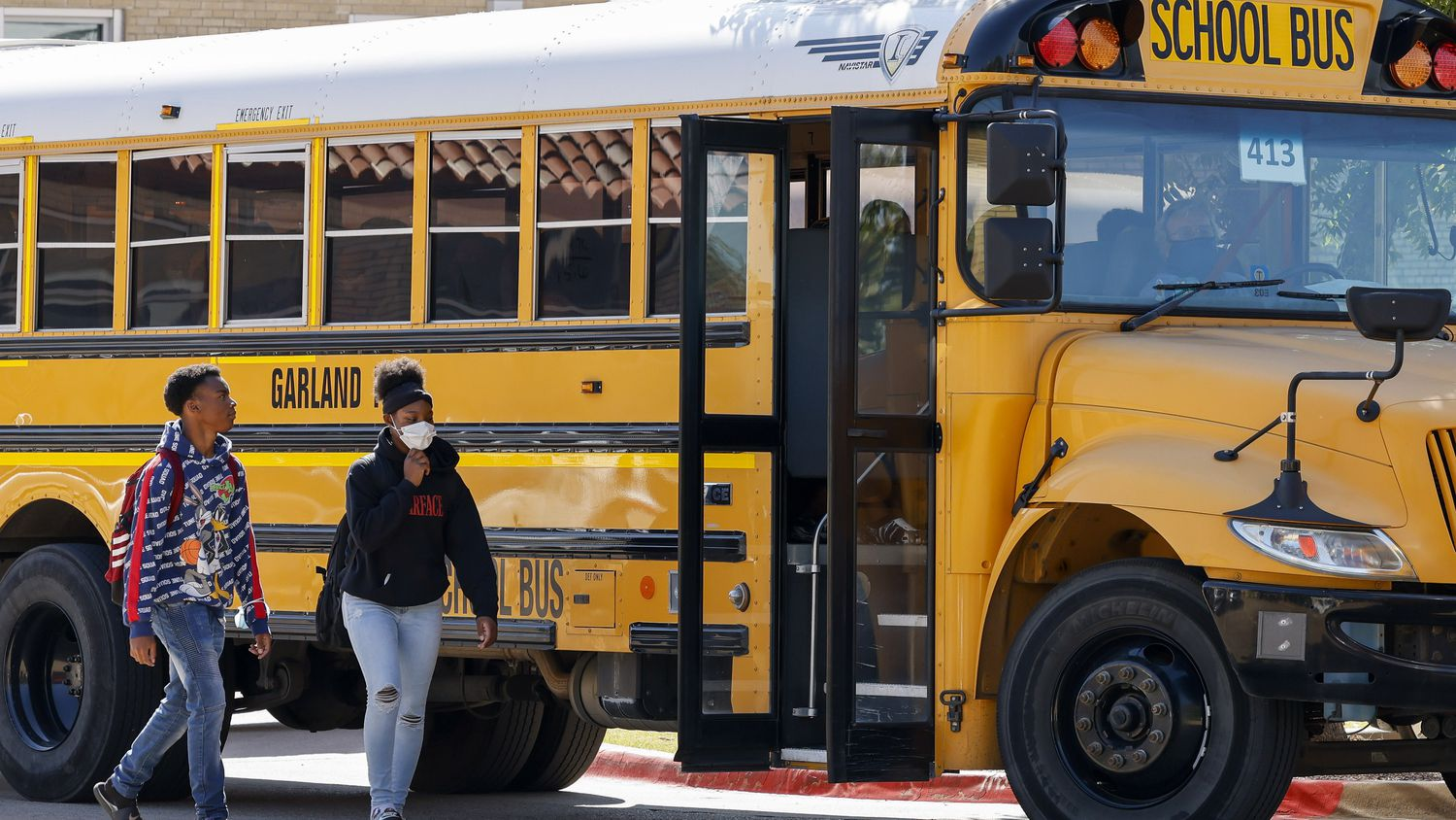 Students boarded a Garland ISD bus outside Garland High School on Oct. 22, 2021.