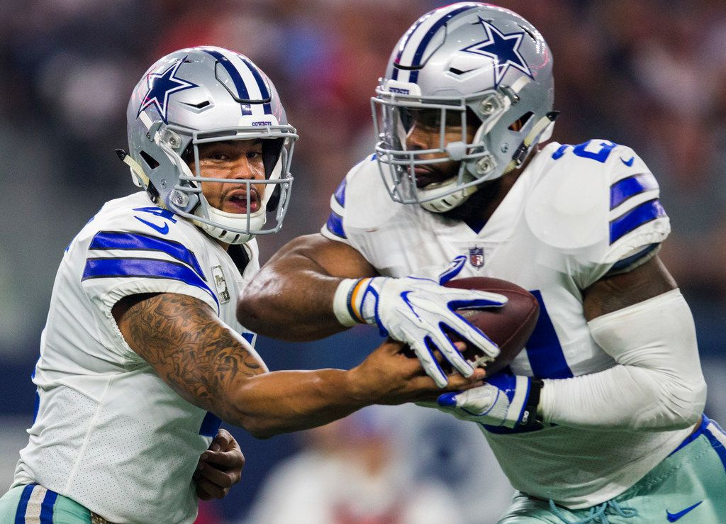 Dallas Cowboys quarterback Dak Prescott (4) hands the ball to running back Ezekiel Elliott (21) during the third quarter of an NFL game between the Dallas Cowboys and the Kansas City Chiefs on Sunday, November 5, 2017 at AT&T Stadium in Arlington, Texas. (Ashley Landis/The Dallas Morning News)