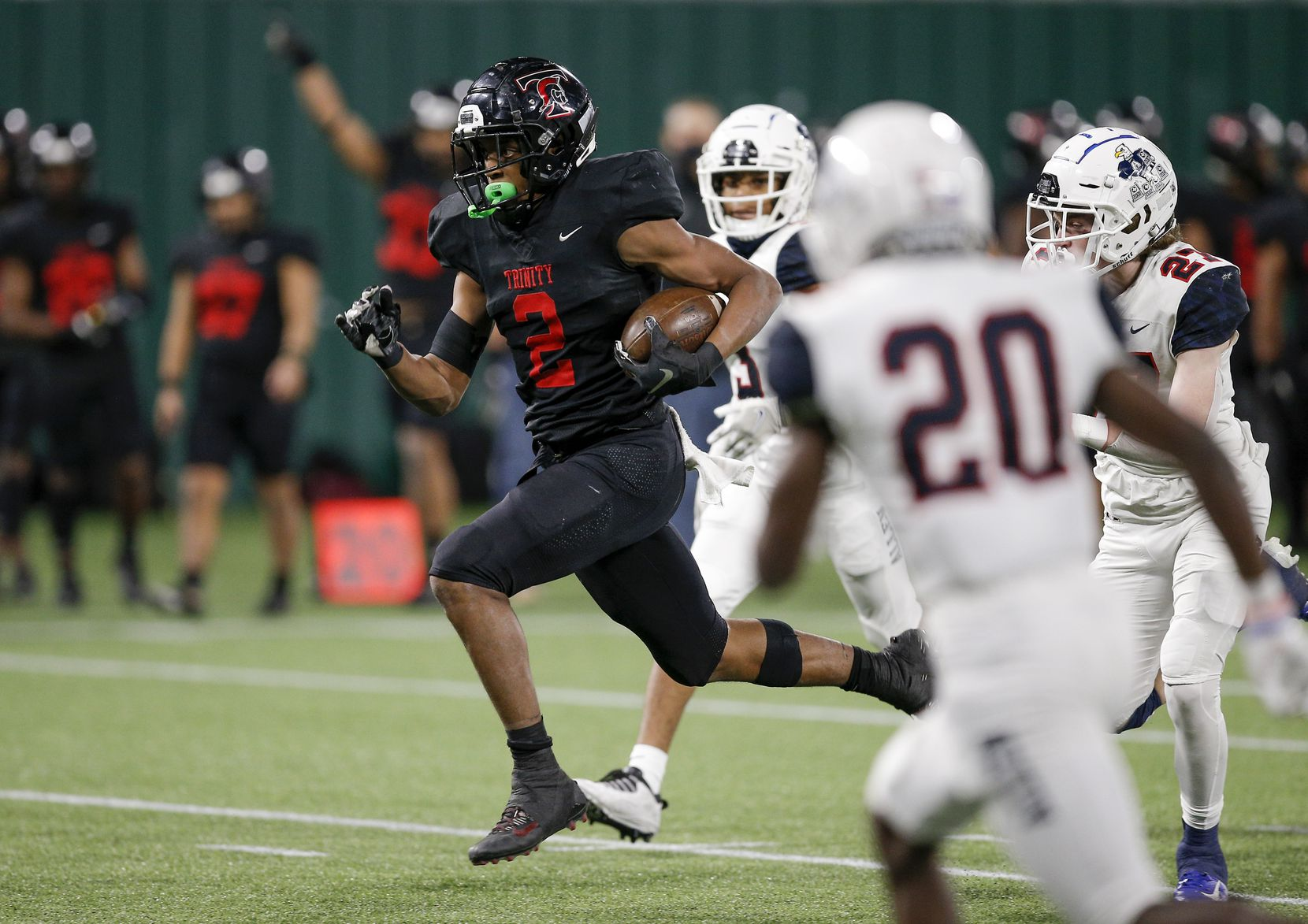 Euless Trinity junior running back Ollie Gordon (2) breaks past the Allen defense to score a touchdown during the second half of a high school Class 6A Division I Region I semifinal football game at Globe Life Park in Arlington, Saturday, December 26, 2020. Trinity won 49-45. (Brandon Wade/Special Contributor)