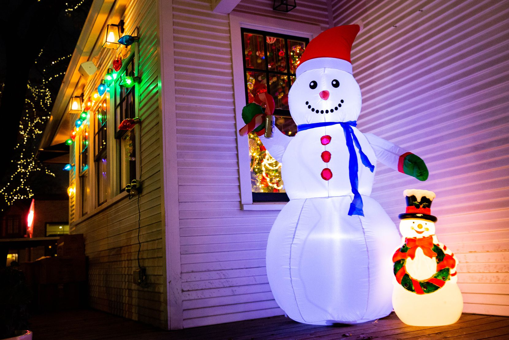 The Tipsy Elf is inside a little white house at the corner of N. Bishop Avenue and Melba Street in Dallas.