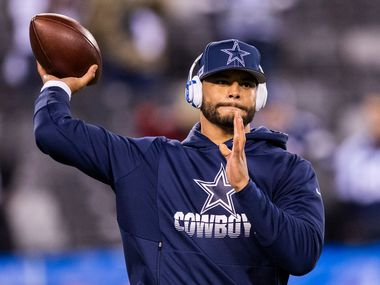 FILE - Cowboys quarterback Dak Prescott (4) warms up before a game against the New York Giants on Monday, Nov. 4, 2019, at MetLife Stadium in East Rutherford, N.J.