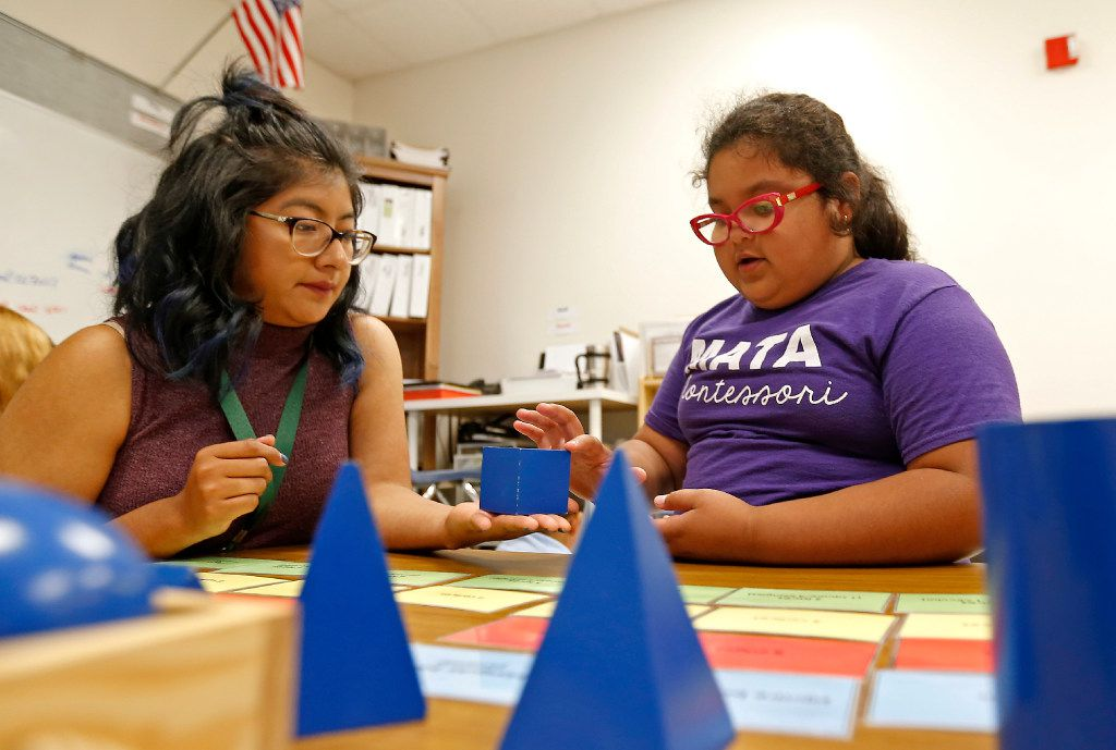 Teacher Veronica Sias (left) helps second-grade student Melanie Arzola during a Lower Elementary Dual Language class at Mata Montessori in Dallas.