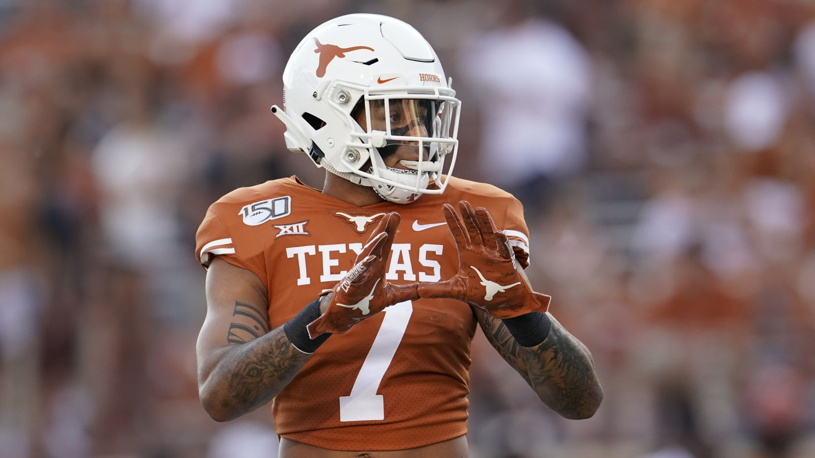 Texas's Caden Sterns (7) warms up before an NCAA college football game against Louisiana Tech in Austin, Texas, Saturday, Aug. 31, 2019.