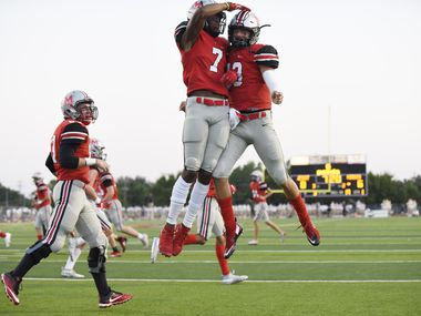 Flower Mound Marcus senior wide receiver J. Michael Sturdivant (7) celebrates with senior quarterback Garrett Nussmeier (13) after the two players connected for the first touchdown of the game versus Jesuit high school, on Friday night, Sept. 25, 2020 at Marauder Stadium in Flower Mound. Ben Torres/Special Contributor