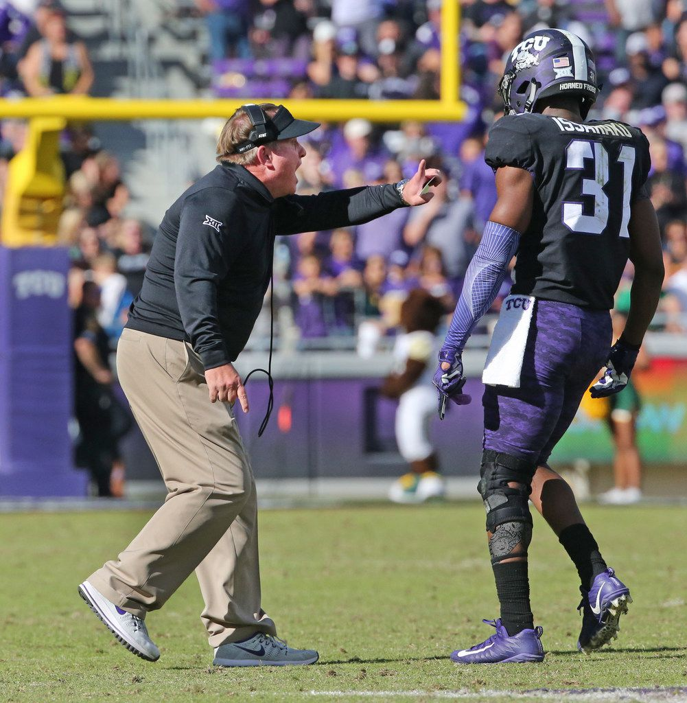 TCU head coach Gary Patterson talks with safety Ridwan Issahaku (31) and other defenders after a skirmish between the teams in the second half during the Baylor University Bears vs. the TCU Horned Frogs NCAA college football game at Amon G. Carter Stadium in Fort Worth, Texas on Friday, November 24, 2017. (Louis DeLuca/The Dallas Morning News)