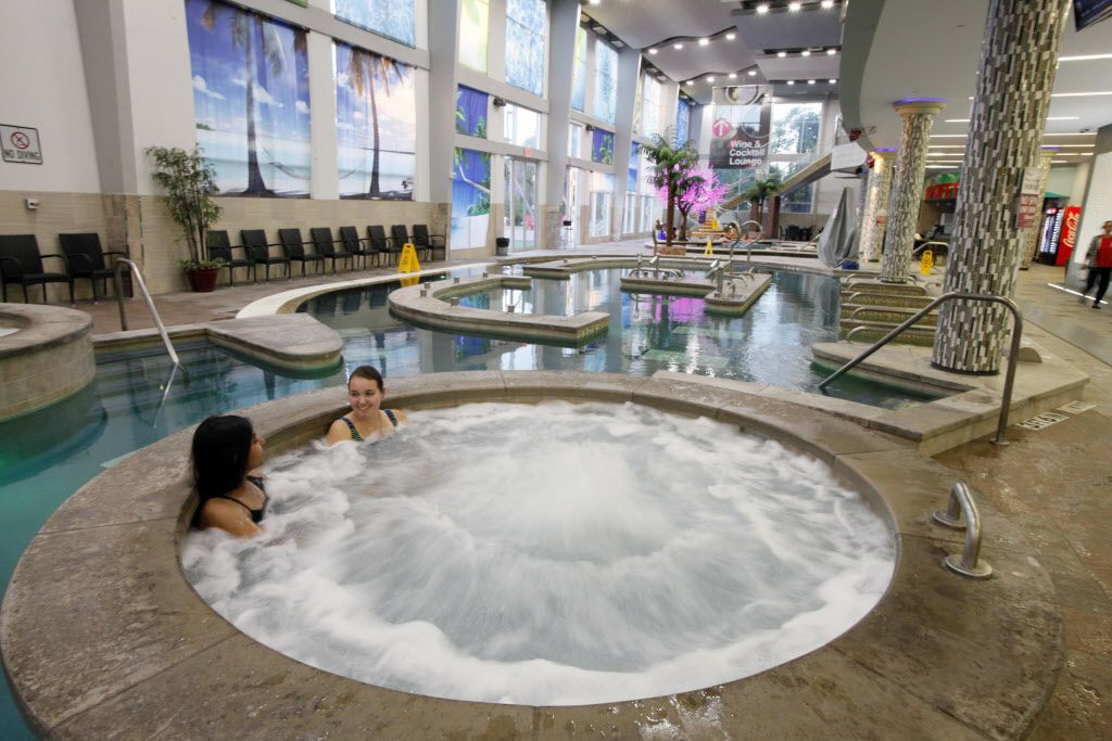 Rachel Kalvin, 18, left, and Madeline Boehm, 20, both of Dallas, relax in a whirl pool inside King Spa, on Wednesday, Oct. 06, 2015 in Dallas. Ben Torres/Special Contributor