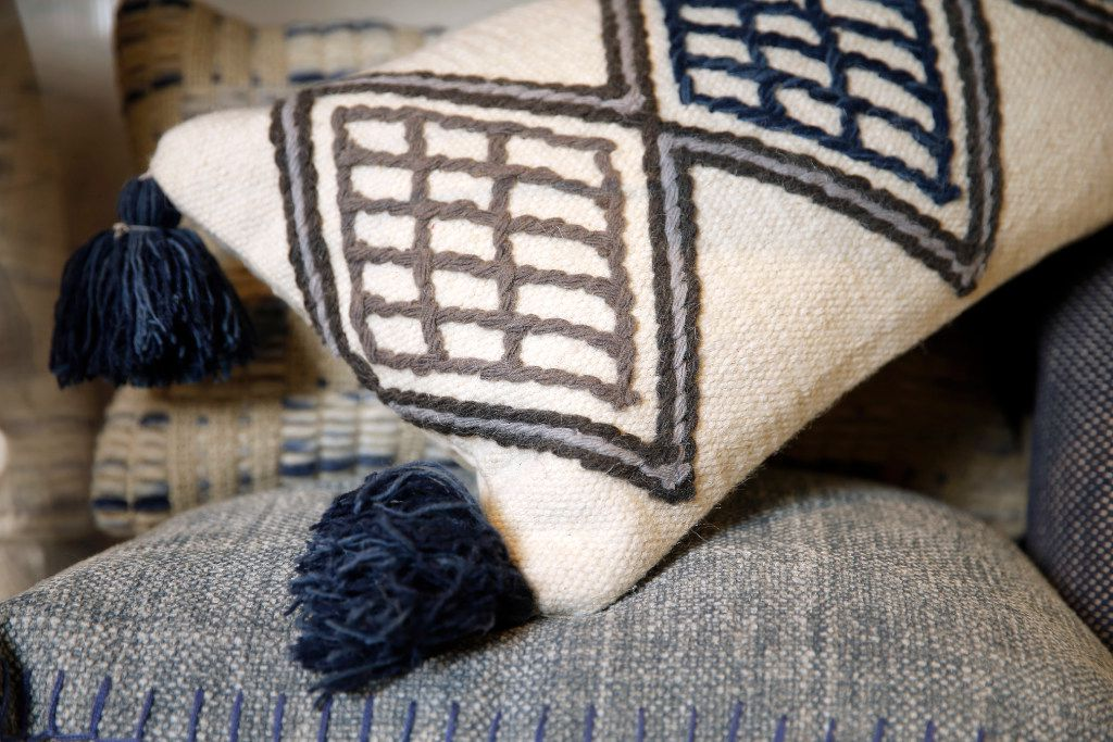 Loloi pillows from the Magnolia Home by Joanna Gaines collection are pictured at their Dallas headquarters. Loloi Rugs is one of the local small businesses wrapping up a great year thanks to the success of Waco's Fixer Upper couple Chip and Joanna Gaines. Loloi makes the rugs, throws and pillows under Joanna's brand that hit stores this fall. (Tom Fox/The Dallas Morning News)