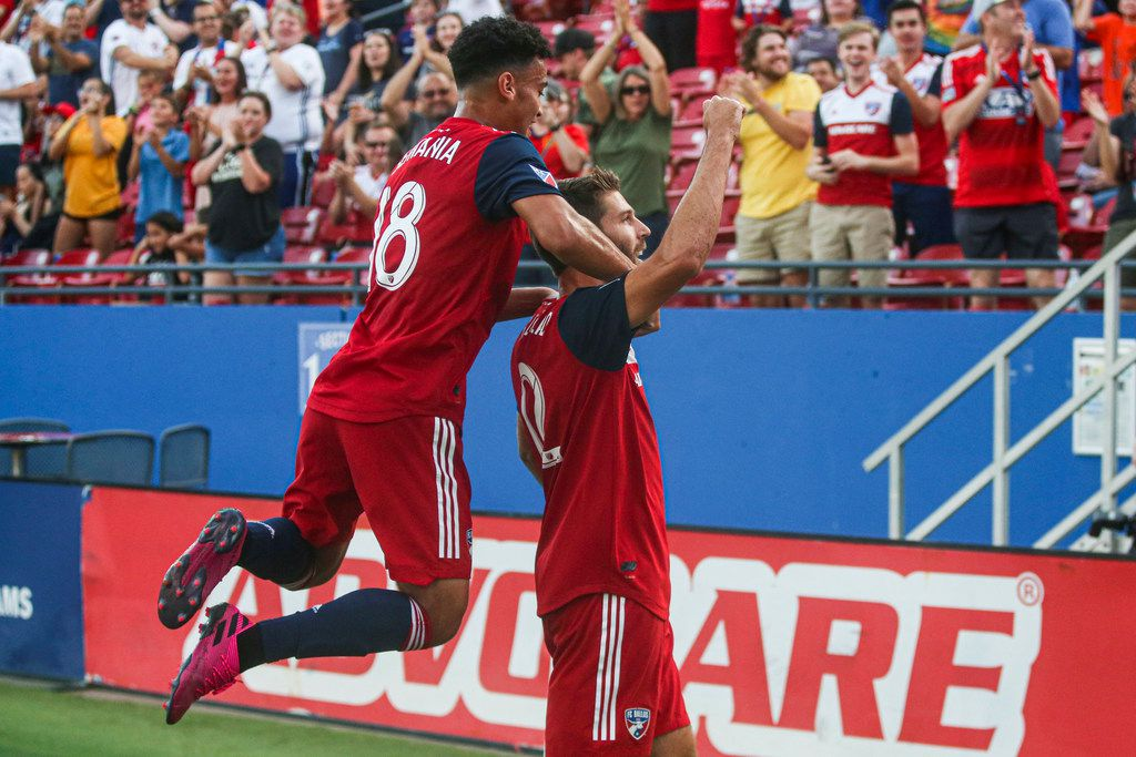 FC Dallas midfielder Brandon Servania (18) celebrates with midfielder Ryan Hollingshead (12) after his goal during the first half of an MLS game between FC Dallas and FC Cincinnati on Saturday, August 31, 2019 at Toyota Stadium in Frisco, Texas. (Shaban Athuman/Staff Photographer)