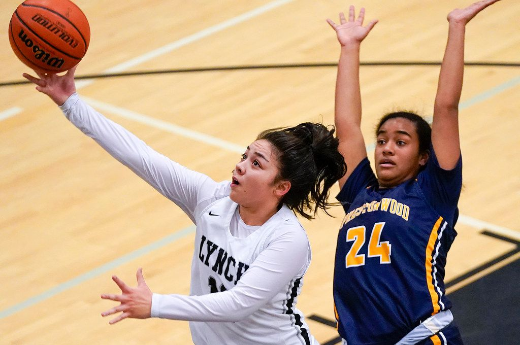 Bishop Lynch guard Talia DePetrillo (11) drives to the basket past Prestonwood Christian forward Bria Stephens (24) during a TAPPS 2-6A high school girls basketball game on Friday, Feb. 7, 2020, in Dallas. Bishop Lynch won the game 59-54. (Smiley N. Pool/The Dallas Morning News)