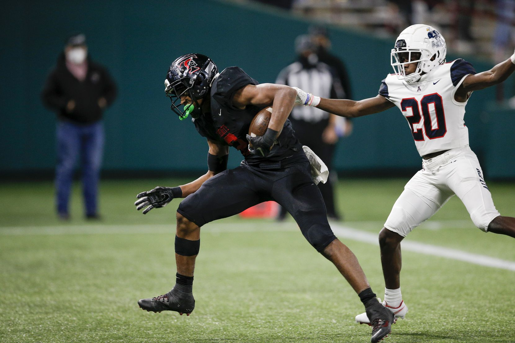 Euless Trinity junior running back Ollie Gordon (2) breaks past Allen junior defense back Sign Shuva (20) to score a touchdown during the second half of a high school Class 6A Division I Region I semifinal football game at Globe Life Park in Arlington, Saturday, December 26, 2020. Trinity won 49-45. (Brandon Wade/Special Contributor)