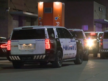 Dallas police vehicles at the scene of a fatal shooting Sunday, Jan. 26, 2020, outside a Walmart located at 15220 Montfort Drive in Far North Dallas.