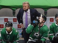 Dallas Stars head coach Rick Bowness (center) is angry with the a referee's interference call against Andrej Sekera late in the third period against the Columbus Blue Jackets at the American Airlines Center in Dallas, Thursday, March 4, 2021.