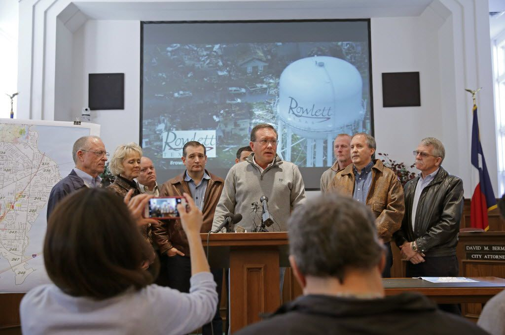 Flanked by Sen. Ted Cruz (left) and Attorney General Ken Paxton, Rowlett Mayor Todd Gottel updated the media on conditions in Rowlett after touring tornado-ravaged areas in December 2015. (File Photo/Tom Fox)