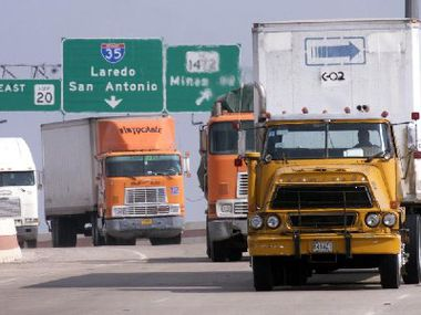 Mexican, American and Canadian trucks head to the World Trade Bridge in Laredo on their way into Mexico.