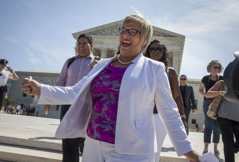 Amy Hagstrom Miller, founder of Whole Woman's Health, a Texas women's health clinic that provides abortions, rejoices as she leaves the Supreme Court in Washington, Monday, June 27, 2016, as the justices struck down the strict Texas anti-abortion restriction law known as HB2. The justices voted 5-3 in favor of Texas clinics that had argued the regulations were a thinly veiled attempt to make it harder for women to get an abortion in the nation's second-most populous state. The case is Whole Woman's Health v. Hellerstedt. (AP Photo/J. Scott Applewhite)