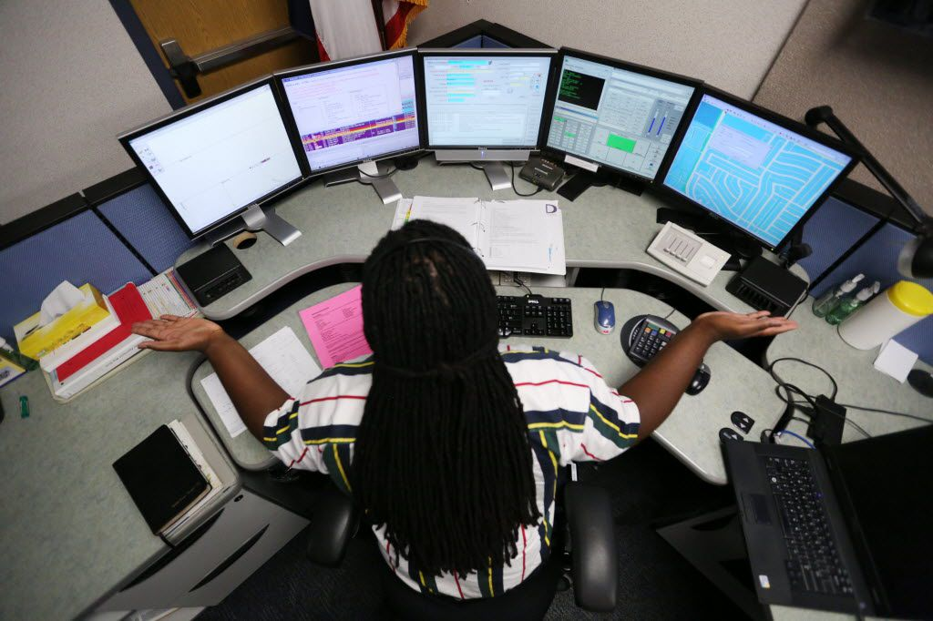 Ward Hughes, of Irving, reacts to a 911 caller inside the dispatch center on the lower level in Plano Municipal Center in Plano, Texas on May 30, 2014. Call takers and dispatchers use a priority medical dispatch system while deciding which services to send after a call is received. (Andy Jacobsohn/The Dallas Morning News)