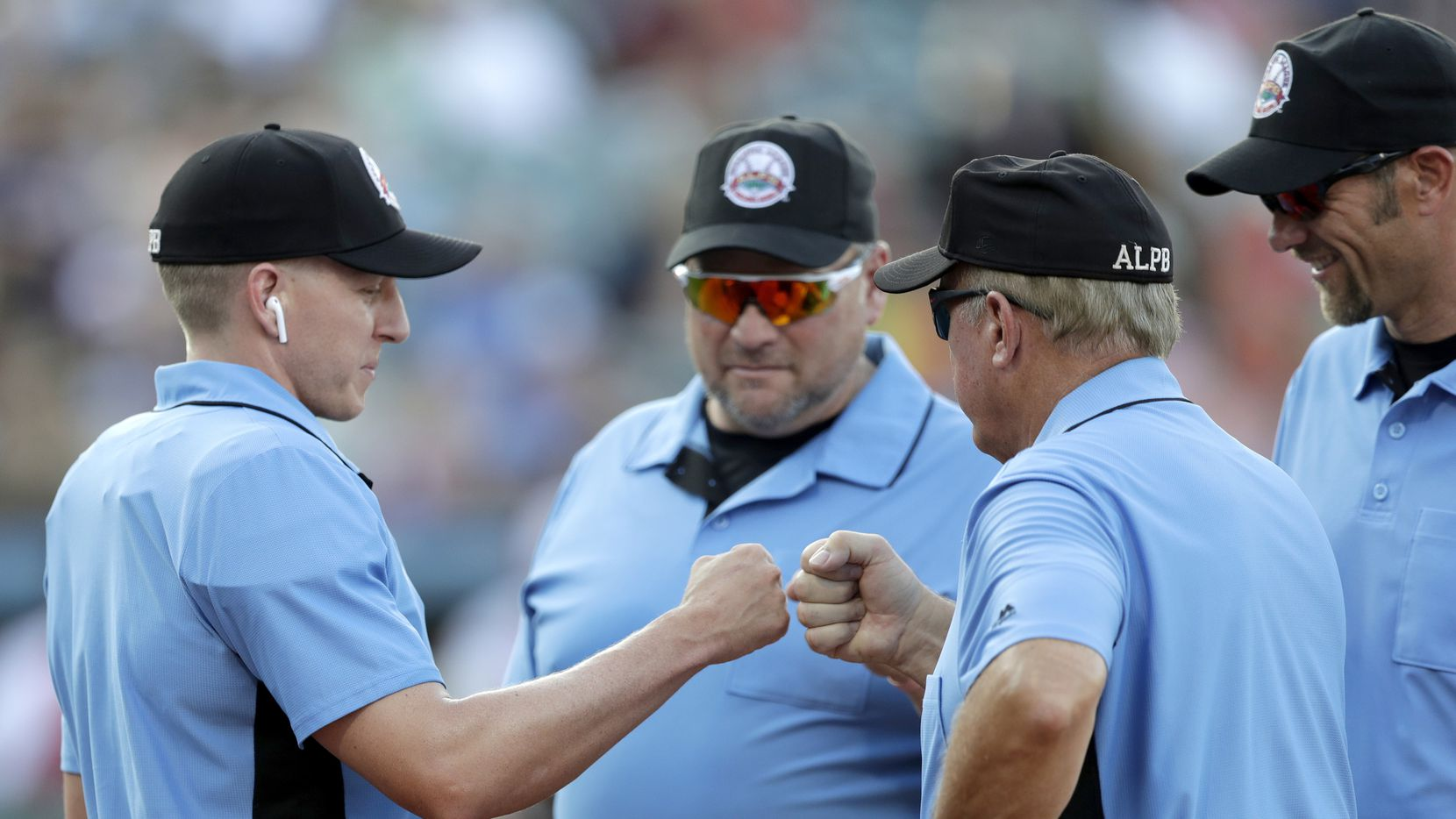 FILE —  Under MLB's new COVID-19 safety rules and guidelines there will be no high-fives, no fist bumps, no hugs, no spitting, no smokeless tobacco, and no sunflower seeds. (AP Photo/Julio Cortez)