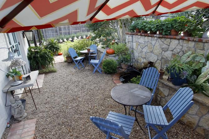 An area outside the kitchen's French doors is called the happy hour courtyard.