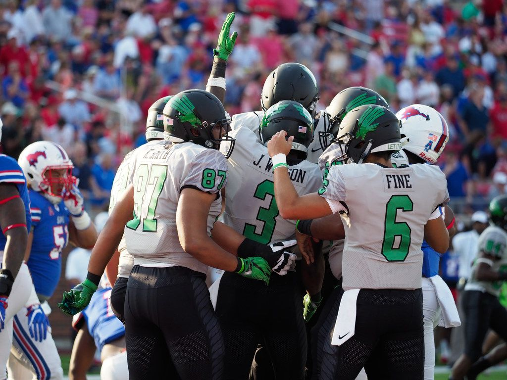 North Texas senior running back Jeffery Wilson (3) celebrates with his teammates after he scores a touchdown against the Southern Methodist defense at Gerald J. Ford Stadium., Saturday, September 9, 2017, in Dallas, Texas,