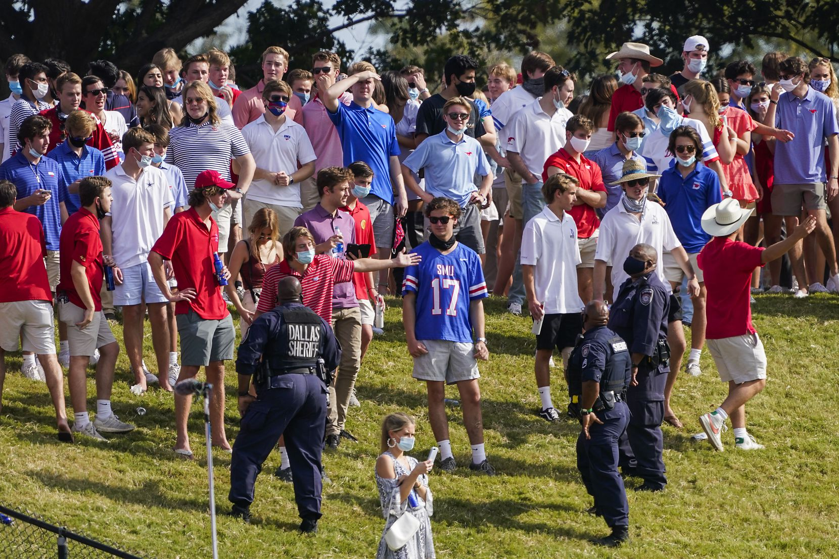 SMU students argue with law enforcement as they clear fans from the hill in the south end zone during the first half of an NCAA football game against Memphis at Ford Stadium on Saturday, Oct. 3, 2020, in Dallas. (Smiley N. Pool/The Dallas Morning News)