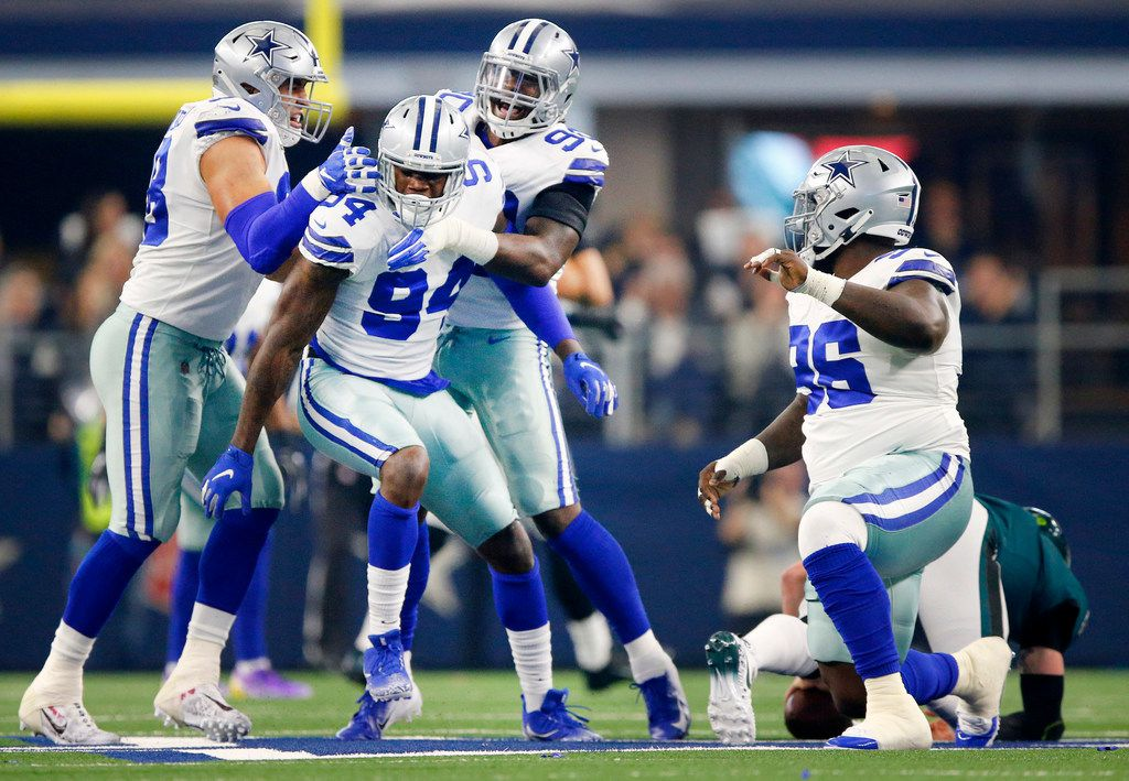 Dallas Cowboys defensive end Randy Gregory (94) is congratulated by teammates Tyrone Crawford (98), Demarcus Lawrence (90) and Maliek Collins (96) after his sack of Philadelphia Eagles quarterback Carson Wentz (11) in the first quarter at AT&T Stadium in Arlington, Texas, Sunday, December 9, 2018. (Tom Fox/The Dallas Morning News)