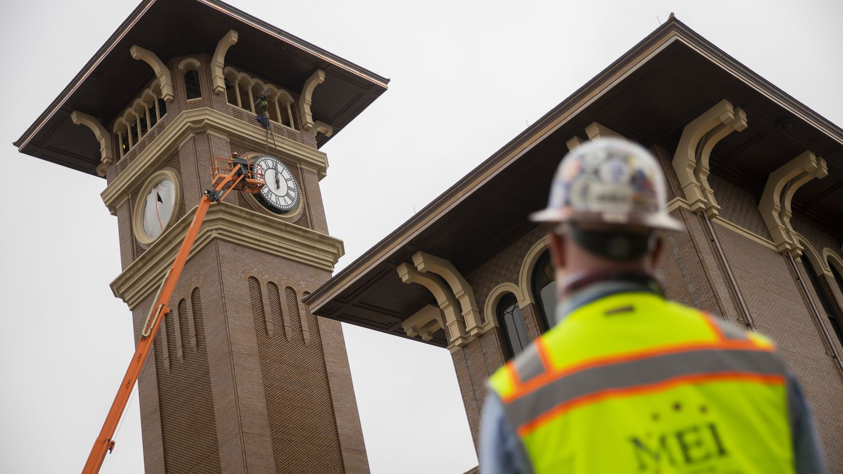 Clint Hoffman, operations manager with MEI Rigging & Crating, watches as his crew works to install a 12-foot glass clock on the Grapevine Main Station's Observation Tower on Sept. 3, 2020 in Grapevine. The clocks designed by Electric Time Company were designed to be compatible with the Texas-Italianate style of the station.