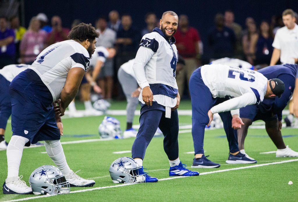 Dallas Cowboys quarterback Dak Prescott (4) smiles during a Dallas Cowboys training camp practice on Thursday, August 22, 2019 at The Star in Frisco. (Ashley Landis/The Dallas Morning News)