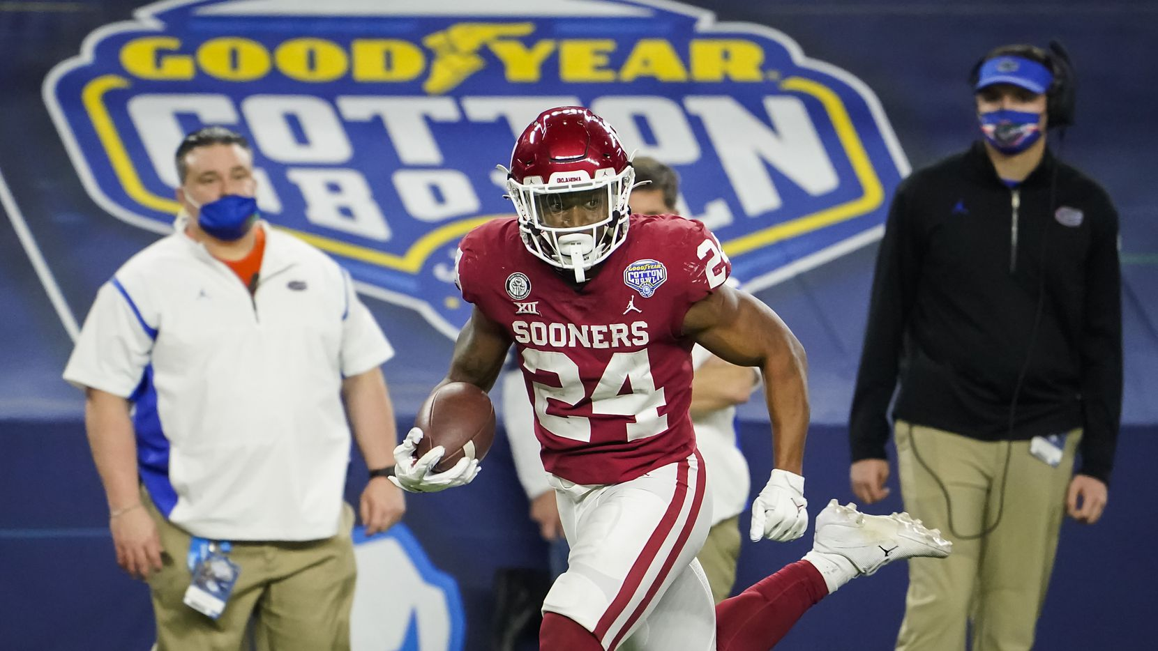 Oklahoma running back Marcus Major (24) races toward the end zone on a 42-yard touchdown run during the second half of the Cotton Bowl Classic against Florida at AT&T Stadium on Wednesday, Dec. 30, 2020, in Arlington.