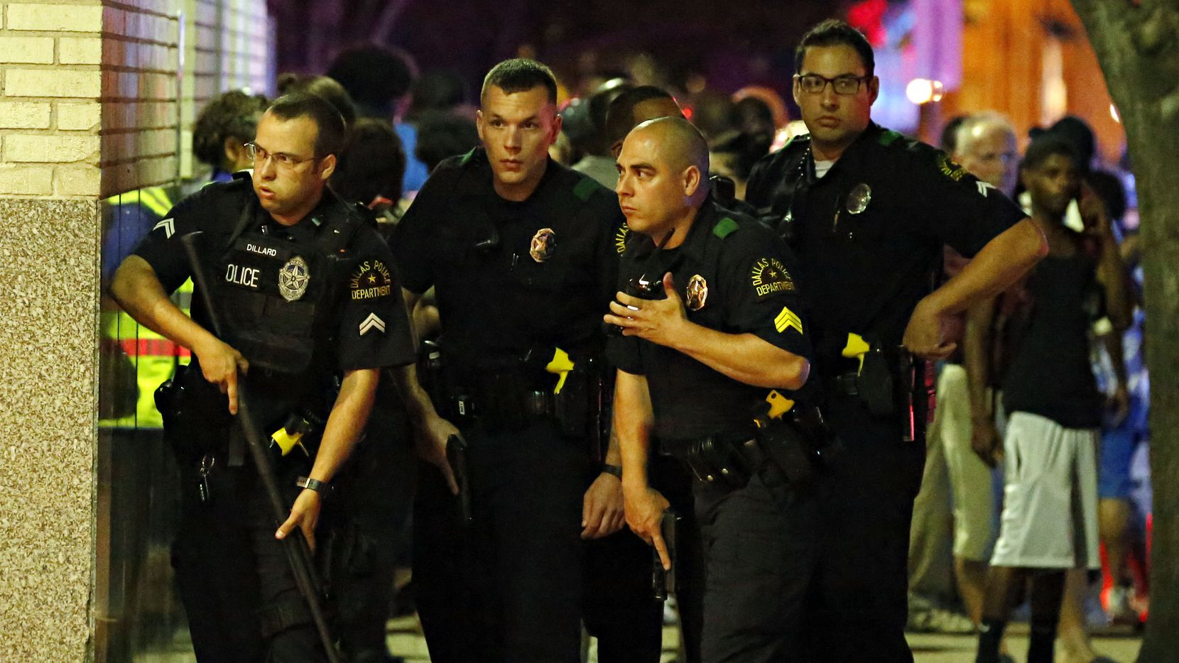 Dallas police officers prepared to enter a parking garage during the ambush July 7. Five officers died after a lone gunman opened fire on police downtown.