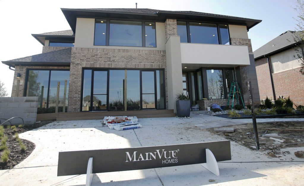 Exterior view of the MainVue Homes Carmel Q1 model home at Phillips Creek Ranch in Frisco, on Tuesday, February 17, 2015. (Vernon Bryant/The Dallas Morning News) 02272015xBIZ